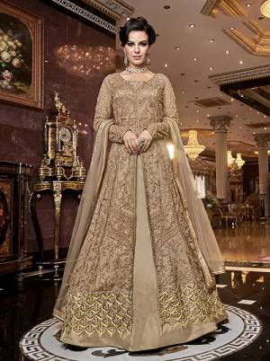 Rich And Elegant Looking Designer Indo-Western Suit Is Here In Beige Which Comes With Two Bottoms. Its Heavy Embroidered Top Is Fabricated On Net Paired With Satin Fabricated Embroidered Bottom , A Satin Fabricated Lehenga And Net Fabricated Dupatta. All Its Fabrics Are Light Weight And Easy To Carry Throughout The Gala.