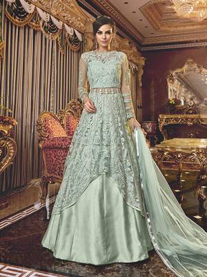 Another Two Way Suit IS Here With This Designer Indo Western Suit Baby Blue Color.  Its Pretty Tone To Tone Embroidered Top IS Net Based Paired With Net Bottom , Satin Lehenga And Net Fabricated Dupatta.