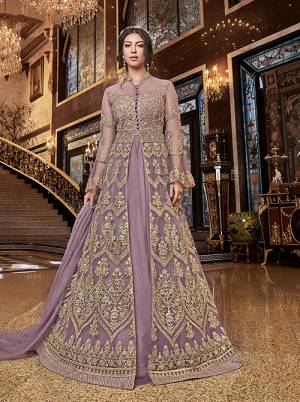 Lovely Shade Is Here To Add Into Your Wardrobe With This Two-Way Indo-Western Suit In Lilac Color. Its Heavy Embroidered Top Is Fabricated On Net Paired With Art Silk Fabricated Embroidered Bottom And Net Fabricated Lehenga With Net Dupatta. Buy This Pretty Suit Now.
