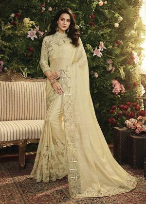 Flaunt Your Rich And Elegant Taste Wearing This Elegant Looking Designer Saree Cream Color Paired With Cream Colored Blouse. This Saree Is Fabricated On Satin Silk And Net Paired With Art Silk And Net Fabricated Blouse. It Is Beautified With Attrative Fancy Embroidery which Will Earn You Lots Of Compliments From Onlookers.