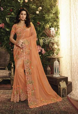 Shine Bright Wearing This Heavy Designer Saree In Orange Color Paired With Orange Colored Blouse. This Saree Is Fabricated On Tissue And Net Paired With Art Silk Fabricated Blouse. It Is Beautified With Heavy Embroidery, Buy Now.