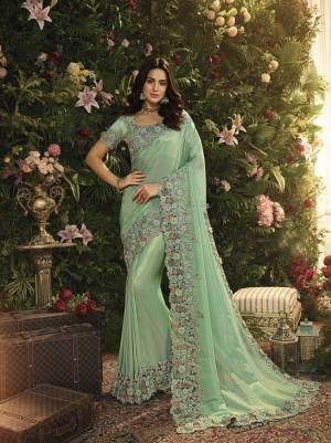 Lovely Shade Is Here To Add Into Your Wardrobe With This Heavy Designer Saree In Mint Green Color. This Saree Is Fabricated On Tissue And Net Paired With Art Silk Fabricated Blouse. Both Are Beautified With Heavy Contrasting Embroidery.