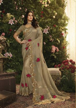 New And Unique Shade In English Color Is Here With This Elegant Looking Sand Grey Colored Saree Paired With Sand Grey Colored Blouse. This Saree Is Fabricated On Tissue Beautified With Contrasting Work Paired With Art Silk Fabricated Blouse.