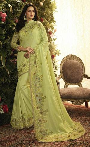 Here Is A Pretty Looking Heavy Designer Saree In Light Green Color Paired With Light Green Colored Blouse. This Saree And Blouse Are Fabricated On Art Silk And Net Beautified With Heavy Detailed Embroidery. Buy This Lovely Saree Now.