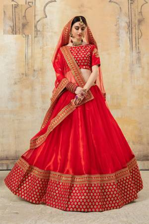 Adorn The Pretty Angelic Look Wearing This Designer Lehenga Choli In All Over Red Color. Its Pretty Blouse Is Fabricated On Net Paired With Net Fabricated Lehenga And Dupatta. It IS Beautified With Heavy Embroidery Making It More Attractive With Red.