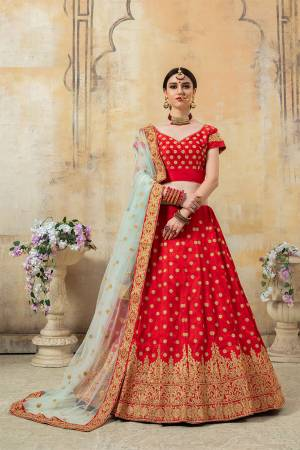 Lovely Color Pallete Is Here With This Heavy Designer Lehenga Choli In Red Color Paired With Contrasting Baby Blue Colored Dupatta. Its Heavy Embroidered Blouse And Lehenga Are Fabricated On Art Silk Paired With Net Fabricated Dupatta.