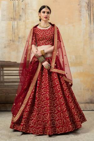 You Will Definitely Earn Lots Of Compliments Wearing This Heavy Designer Lehenga Choli In Lovely Red Color. This Pretty Lehenga Choli Is Silk Based Paired With Net Fabricated Dupatta. Buy Now.