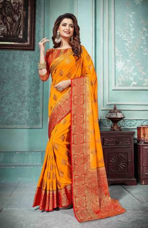 This Festive Season Be The Most Elegant In Traditional Wear With This Silk Based Saree In Orange Color Paired With Contrasting Red Colored Blouse. Its Rich Fabric Is Durable, Light Weight And Easy To Care For.