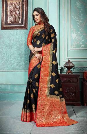 Grab This Beautiful Designer Silk Based Saree In Black Color Paired With Red Colored Blouse. This Saree And Blouse Are Fabricated On Art Silk Beautified With Weave All Over. Buy Now.