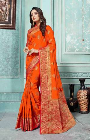 This Festive Season Be The Most Elegant In Traditional Wear With This Silk Based Saree In Dark Orange Color Paired With Contrasting Red Colored Blouse. Its Rich Fabric Is Durable, Light Weight And Easy To Care For.