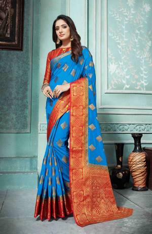 Grab This Beautiful Designer Silk Based Saree In Blue Color Paired With Red Colored Blouse. This Saree And Blouse Are Fabricated On Art Silk Beautified With Weave All Over. Buy Now.