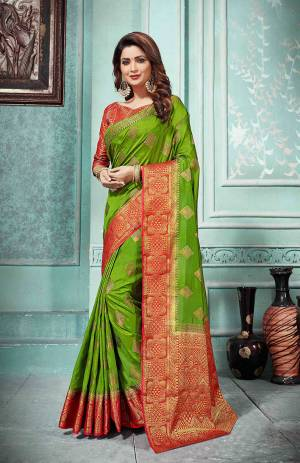 This Festive Season Be The Most Elegant In Traditional Wear With This Silk Based Saree In Green Color Paired With Contrasting Red Colored Blouse. Its Rich Fabric Is Durable, Light Weight And Easy To Care For.