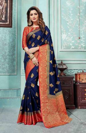 Grab This Beautiful Designer Silk Based Saree In Navy Blue Color Paired With Red Colored Blouse. This Saree And Blouse Are Fabricated On Art Silk Beautified With Weave All Over. Buy Now.
