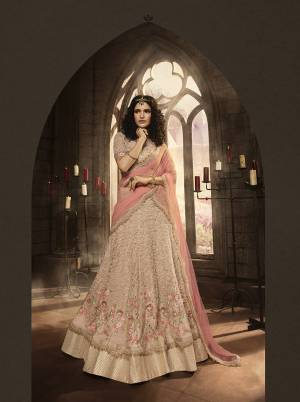 This Season Is About Subtle Shades And Pastel Play, So Grab This Heavy Designer Lehenga Choli In Pastel Pink Color Paired With Pink Colored Dupatta. It Is Beautified With Heavy Contrasting Embroidery And Jari Work. Buy This Pretty Piece Now.