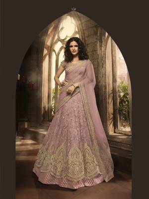 New Shade In Purple Is Here With This Heavy Designer Lehenga Choli In Lilac Color. Its Blouse, Lehenga And Dupatta Are Fabricated On Net Beautified With Heavy Jari And Resham Embroidery With Stone Work. Buy Now.