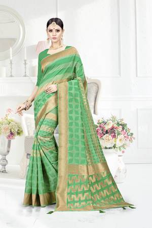 Look Pretty In This Designer Silk Based Green Colored Geonmetric Patterned Saree Paired With Green Colored Blouse. This Saree Is Fabricated On Weaving Silk Paired With Art Silk Fabricated Blouse. Buy This Saree Now