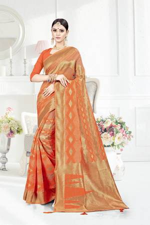 Grab This Pretty Geometric Patterned Saree In Orange Color Paired With Orange Colored Blouse. This Saree Is Fabricated On Weaving Silk Paired With Art Silk Fabricated Blouse. This Pretty Saree Is Light Weight, Durable And Easy To Care For.