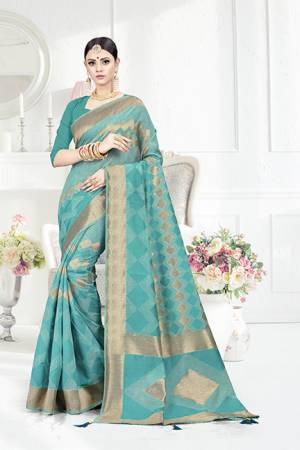 Look Pretty In This Designer Silk Based Turquoise Blue Colored Geonmetric Patterned Saree Paired With Turquoise Blue Colored Blouse. This Saree Is Fabricated On Weaving Silk Paired With Art Silk Fabricated Blouse. Buy This Saree Now