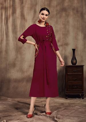 Grab This Bold And Beautiful Looking Designer Readymade Kurti In Magenta Pink Color Fabricated On Muslin. It Is Beautified With Attractive Embroidery With Thread And Buttons.