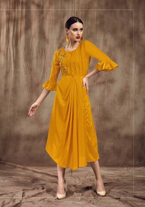 Celebrate This Festive Season Wearing This Designer Drape Patterened Readymade Kurti In Musturd Yellow Color . This Pretty Kurti Is Fabricated On Mulsin And Beautified With Embroidery.