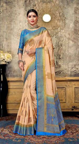 Look Elegant With This Rich Looking Silk Based Saree In Light Peach Color Paired With Contrasting Blue Colored Blouse. This Saree Is Fabricated On Art Silk Paired With Jacquard Silk Fabricated Blouse. It Is Beautified With Elegant Weave Giving An Attractive Look.