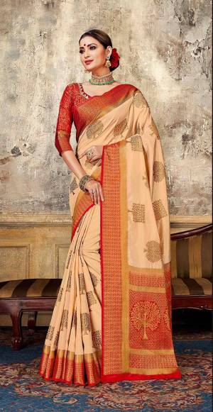 Look Elegant With This Rich Looking Silk Based Saree In Light Peach Color Paired With Contrasting Red Colored Blouse. This Saree Is Fabricated On Art Silk Paired With Jacquard Silk Fabricated Blouse. It Is Beautified With Elegant Weave Giving An Attractive Look.