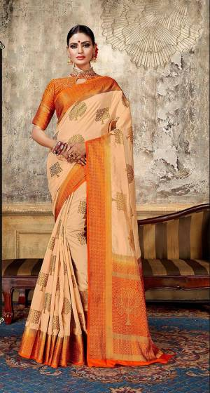 Look Elegant With This Rich Looking Silk Based Saree In Light Peach Color Paired With Contrasting Orange Colored Blouse. This Saree Is Fabricated On Art Silk Paired With Jacquard Silk Fabricated Blouse. It Is Beautified With Elegant Weave Giving An Attractive Look.