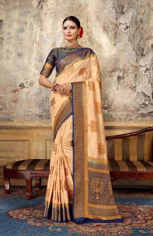 Look Elegant With This Rich Looking Silk Based Saree In Light Peach Color Paired With Contrasting Navy Blue Colored Blouse. This Saree Is Fabricated On Art Silk Paired With Jacquard Silk Fabricated Blouse. It Is Beautified With Elegant Weave Giving An Attractive Look.
