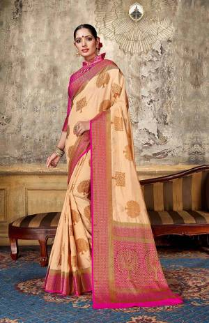 Look Elegant With This Rich Looking Silk Based Saree In Light Peach Color Paired With Contrasting Pink Colored Blouse. This Saree Is Fabricated On Art Silk Paired With Jacquard Silk Fabricated Blouse. It Is Beautified With Elegant Weave Giving An Attractive Look.