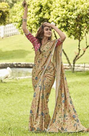 This Festive Season, Look The Most Elegant Of All In This Designer Saree In Beige Color paired With Pink Colored Blouse. This Saree And Blouse Are Silk Based Beautified With Lovely Floral Prints And Lace Border. Buy Now.