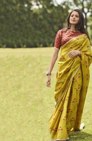 Celebrate This Festive Season With Beauty And Comfort Wearing This Lovely Floral Printed Saree In Musturd Yellow Color Paired With Contrasting Rust Colored Blouse. This Silk Based Saree Is Light Weight And Also Gives A Rich Look.