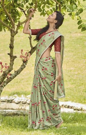 This Season Is About Subtle Shades And Pastel Play,. So Grab This Pretty Saree In Pastel Green Color Paired With Contrasting Rust Red Colored Blouse. This Saree And Blouse Are Fabricated On Mainpuri Art Silk Beautified With Floral Prints.