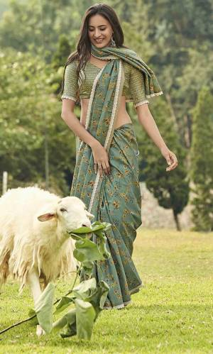 Add This Lovely Shade To Your Wardrobe With This Designer Floral Printed Saree In Teal Green Color Paired With Teal Green Colored Blouse. This Saree And Blouse Are Fabricated On Manipuri Art Silk Which Gives A Rich Look To Your Personality.