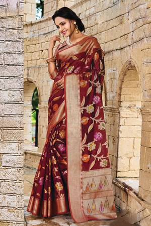 Add This Beautiful Designer Silk Based Saree To Your Wardrobe In Maroon Color For This Festive And Wedding Season. This Rich Silk Based Saree Will Definitely Earn You Lots Of Compliments Which Is Trending This Season.