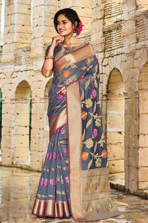 Add This Beautiful Designer Silk Based Saree To Your Wardrobe In Dark Grey Color For This Festive And Wedding Season. This Rich Silk Based Saree Will Definitely Earn You Lots Of Compliments Which Is Trending This Season.