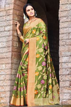 Add This Beautiful Designer Silk Based Saree To Your Wardrobe In Green Color For This Festive And Wedding Season. This Rich Silk Based Saree Will Definitely Earn You Lots Of Compliments Which Is Trending This Season.