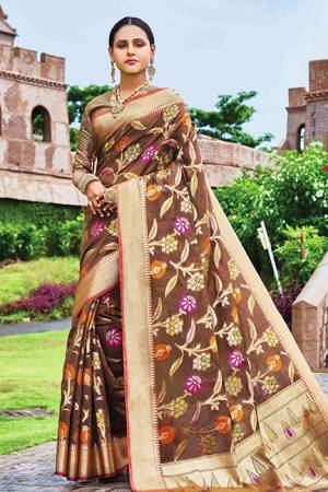 Add This Beautiful Designer Silk Based Saree To Your Wardrobe In Brown Color For This Festive And Wedding Season. This Rich Silk Based Saree Will Definitely Earn You Lots Of Compliments Which Is Trending This Season.