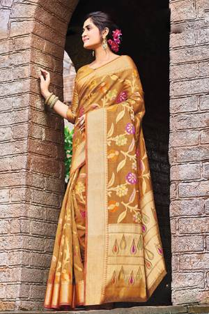 Add This Beautiful Designer Silk Based Saree To Your Wardrobe In Occur Yellow Color For This Festive And Wedding Season. This Rich Silk Based Saree Will Definitely Earn You Lots Of Compliments Which Is Trending This Season.
