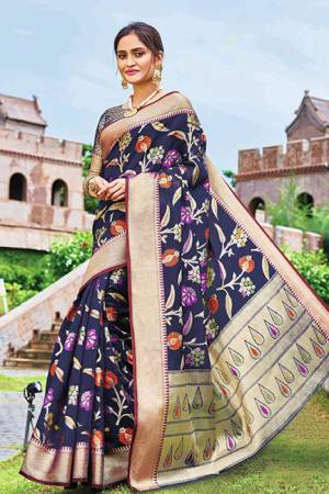 Add This Beautiful Designer Silk Based Saree To Your Wardrobe In Navy Blue Color For This Festive And Wedding Season. This Rich Silk Based Saree Will Definitely Earn You Lots Of Compliments Which Is Trending This Season.