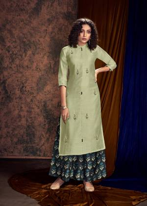 You Will Definitely Earn Lots Of Compliments Wearing This Designer Readymade Pair Of Kurti And Plazzo In Pastel Green And Navy Blue Color Respectively. Its Embroidered Kurti And Printed Plazzo Are Fabricated On Satin Cotton And Available All Regular Sizes.