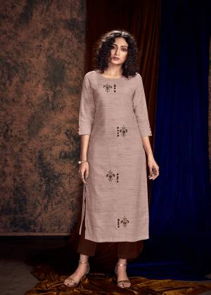 Grab This Designer Pair Of Readymade Kurti And Plazzo In Beige Colored Kurti Paired With Contrasting Brown Colored Plazzo. Its Kurti IS Khadi Silk Based Paired With Rayon Fabricated Bottom. Buy Now.