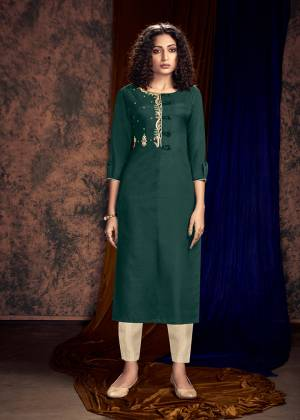 Here Is A Beautiful Shade To Add Into Your Wardrobe With This Readymade Kurti In Teal Green Color Paired With Cream Colored Bottom. Its Top Is Silk Based Paired With Satin Cotton Fabricated Readymade Bottom.