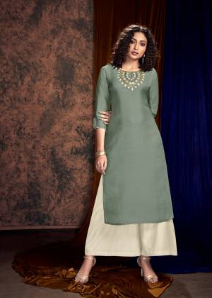 You Will Definitely Earn Lots Of Compliments Wearing This Designer Readymade Pair Of Kurti And Plazzo In Grey And Off-White Color Respectively. Its Embroidered Kurti Is Satin Silk Based Paired With Satin Cotton Fabricated Plazzo, Also It Is Available All Regular Sizes.