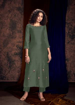 New And Unique Shade IS Here To Add Into Your Wardrobe With This Readymade Pair Of Kurti And Plazzo In Teal Grey Color. This Lovely Designer Pair Is Fabricated On Art Silk Which Also Gives A Rich Look To Your Personality.