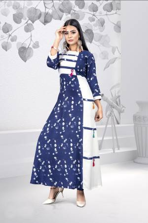 Simple And Elegant Looking Kurti Is Here For Your Casual And Semi-Casual Wear. This Pretty Kurti Is Fabricated On Rayon Beautified With Prints All Over.