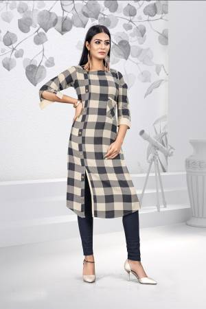 Grab This Designer Readymade Kurti For The Upcoming Festive Season. This Kurti Is Rayon Based Beautified With Prints.