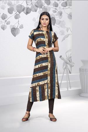 Add This Pretty Readymade Kurti To Your Wardrobe For Your Casual And Semi-Casual Wear. This pretty Kurti Is Fabricated on Rayon Which Ensures Superb Comfort And Also It Is Easy To Care For.