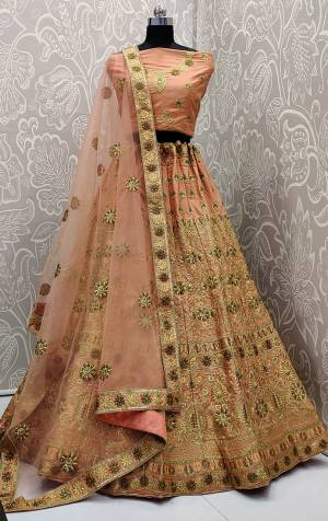Get Ready For The Upcoming Wedding Season With This Very Pretty Heavy Embroidered Designer Lehenga Choli In Peach Color. This Beautiful Lehenga Choli Is Fabricated On Satin Silk Paired With Net Fabricated Dupatta. Buy Now.