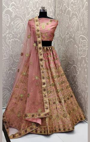 Get Ready For The Upcoming Wedding Season With This Very Pretty Heavy Embroidered Designer Lehenga Choli In Pink Color. This Beautiful Lehenga Choli Is Fabricated On Satin Silk Paired With Net Fabricated Dupatta. Buy Now.