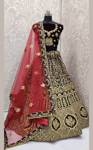 Here Is a Proper Heavy Traditional Lehenga Choli For The Upcoming Wedding Season In Dark Maroon Color Paired with A Very Pretty Red Colored Dupatta. This Heavy Embroidered Designer Lehenga Choli Is Fabricated On Velvet Paired With Net Fabricated Dupatta. Buy This Beautiful Traditional Piece Now.